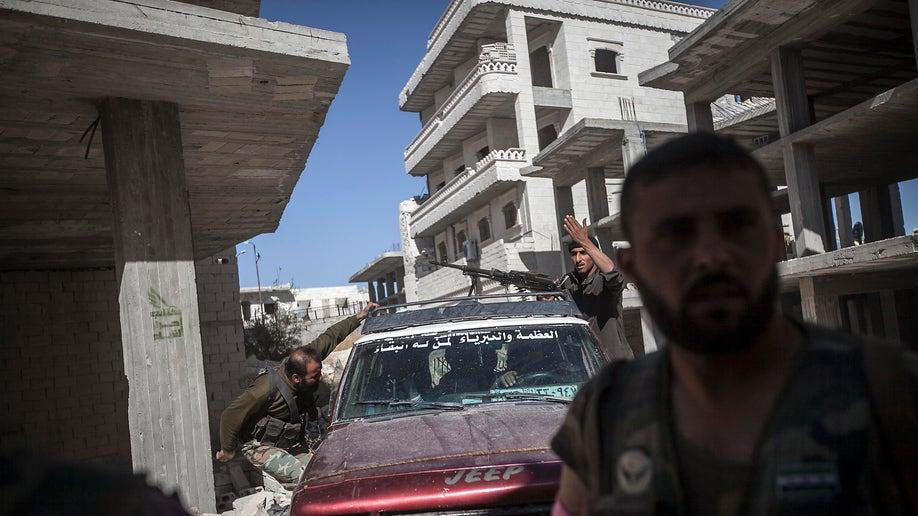b3d66332-APTOPIX Mideast Syria