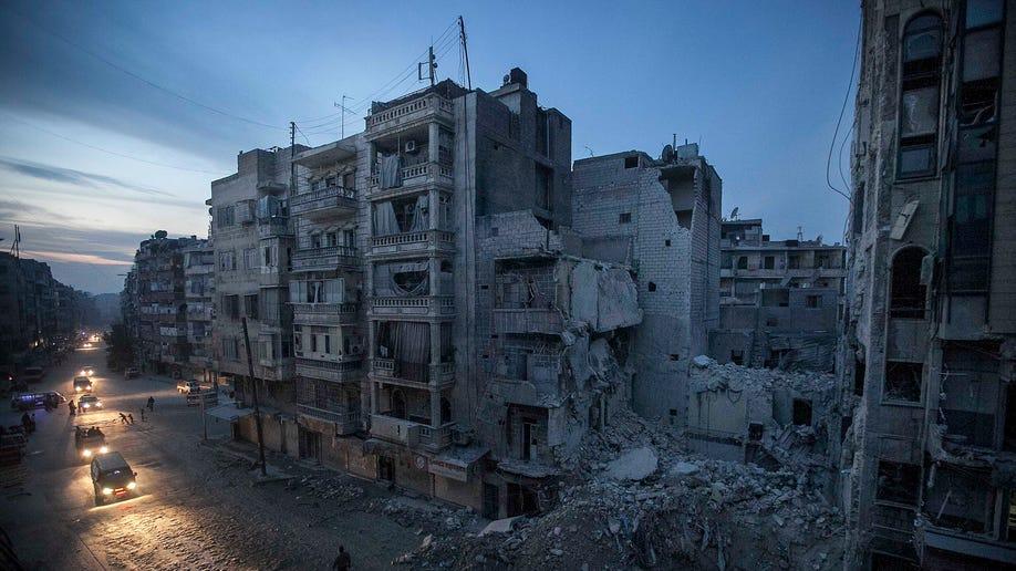 4fc2ab7e-APTOPIX Mideast Syria