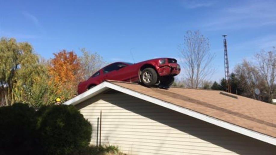 d2277ba2-ODD Car On Roof