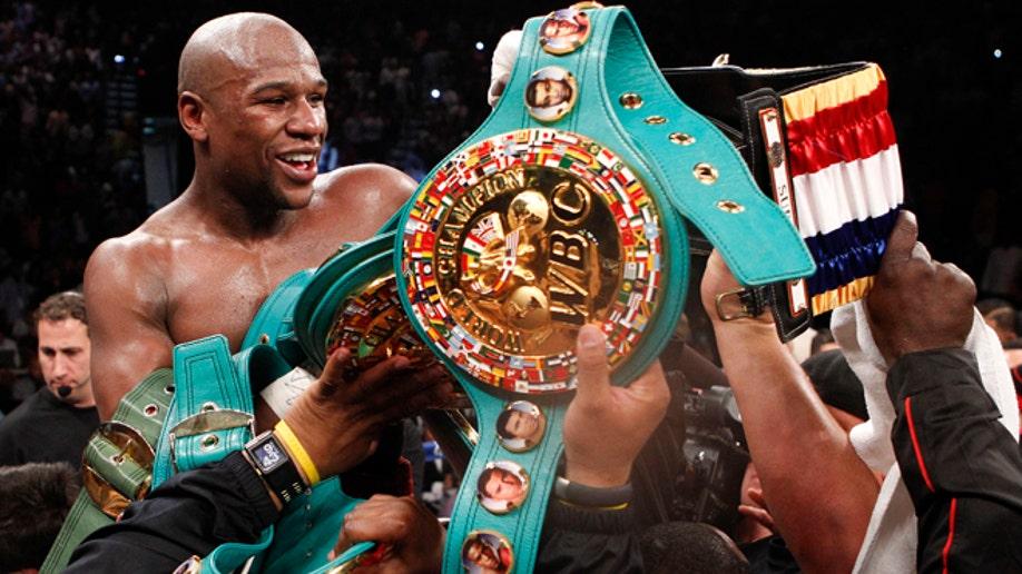 a042a7e9-Mayweather Cotto Boxing