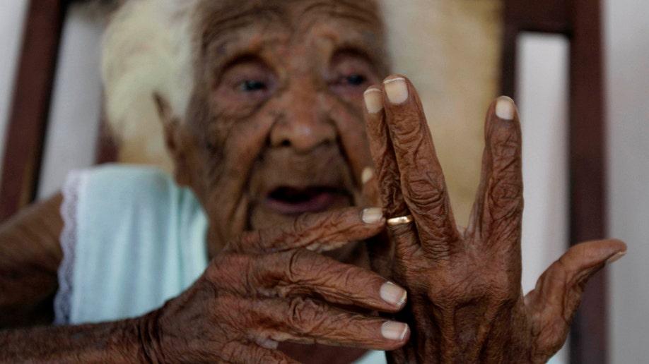 APTOPIX Cuba Old Woman