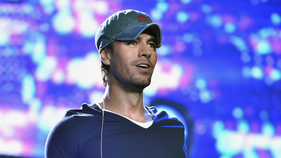 NEWARK, NJ - SEPTEMBER 12:  Enrique Iglesias and Pitbull with special guest J Balvin perform at opening night of U.S. tour at Prudential Center on September 12, 2014 in Newark, New Jersey.  (Photo by Theo Wargo/Getty Images for AEG Live)