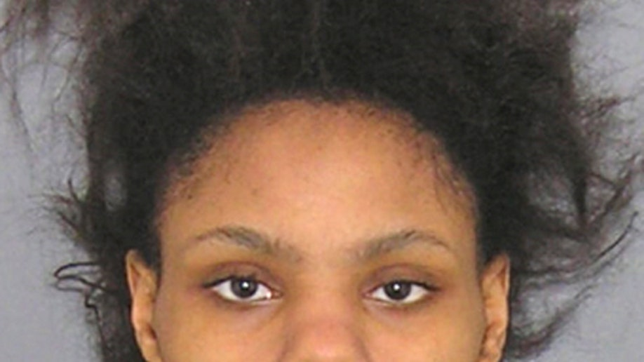 d1f296c0-Infant Decapitated Mother Charged