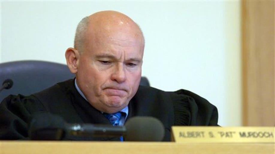 801bcd48-Judge Arrested Rape