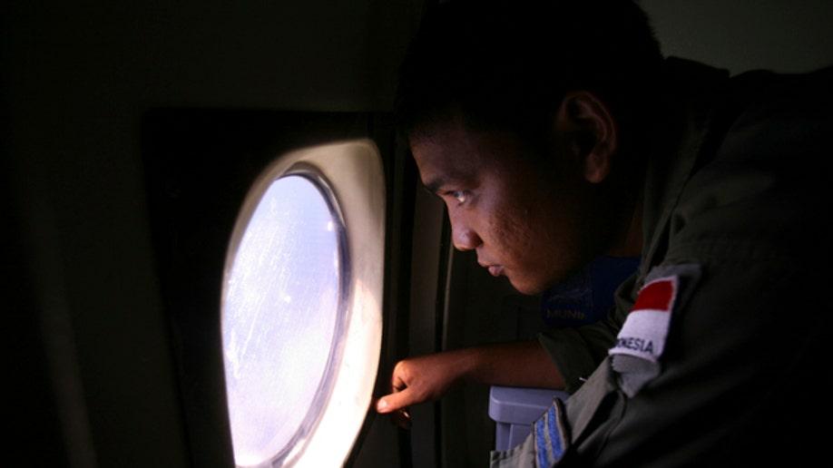 APTOPIX Indonesia Malaysia Plane