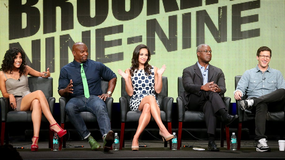 """BEVERLY HILLS, CA - AUGUST 01:  (L-R) Actors Stephanie Beatriz, Terry Crews, Melissa Fumero, Andre Braugher, and Andy Samberg speak onstage during the """"Brooklyn NINE-NINE"""" panel discussion at the FOX portion of the 2013 Summer Television Critics Association tour - Day 9 at The Beverly Hilton Hotel  on August 1, 2013 in Beverly Hills, California.  (Photo by Frederick M. Brown/Getty Images)"""