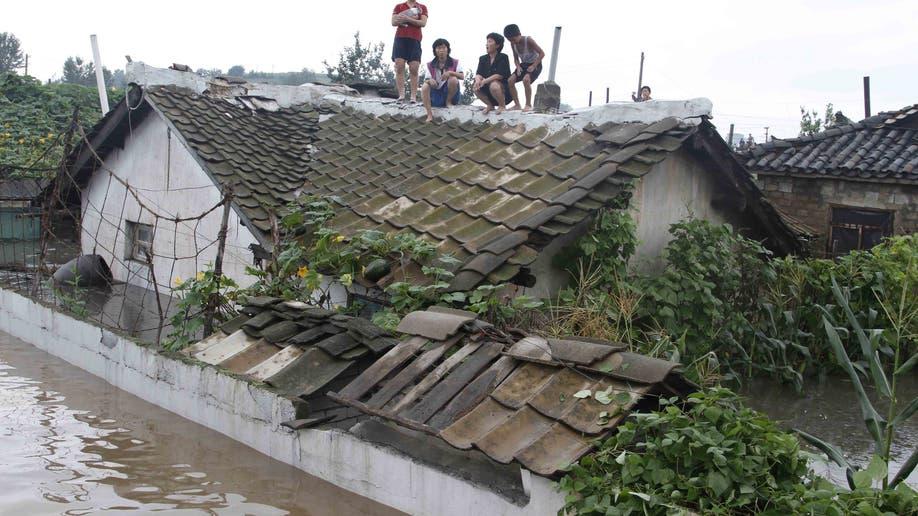 5949c718-North Korea Flood Damage