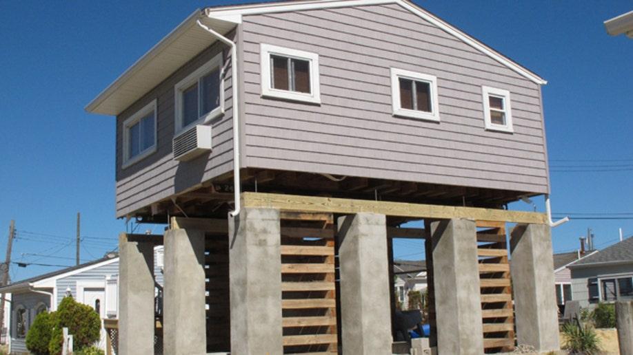 90b82732-Homes-Raising Houses