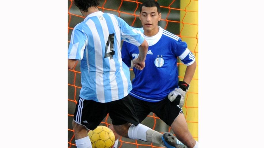 480234bf-Soccer Player Shot