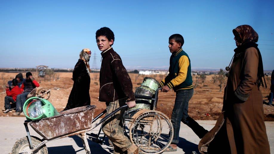 9d6090fa-Mideast Jordan Kuwait Syrian Aid