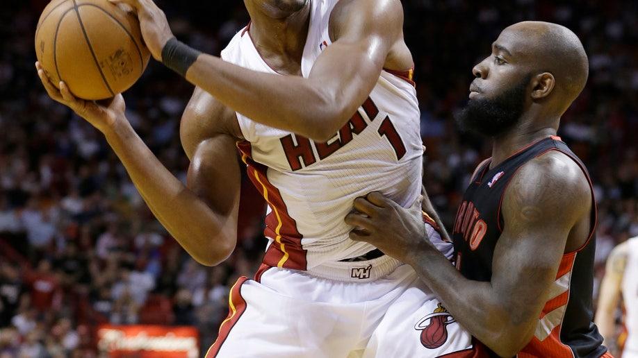 64d774b8-Raptors Heat Basketball