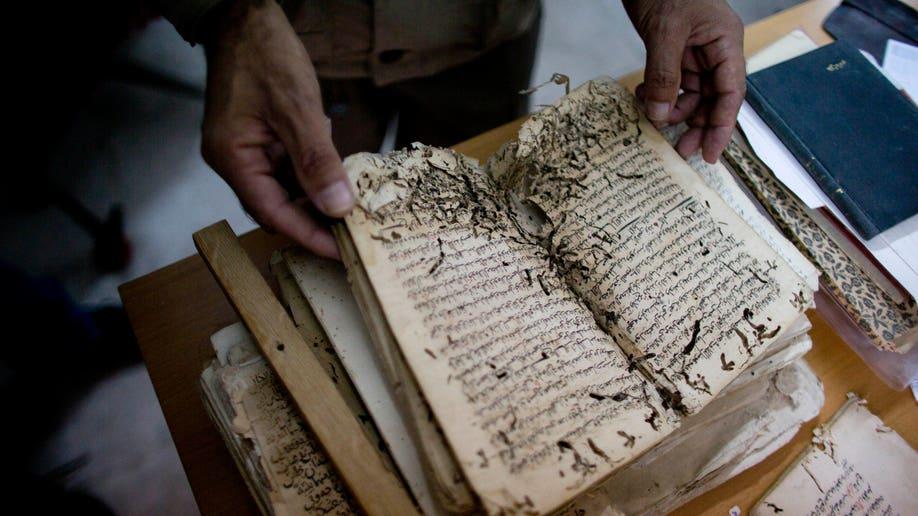 5c5aa149-Mideast Jerusalem Mosque Manuscripts