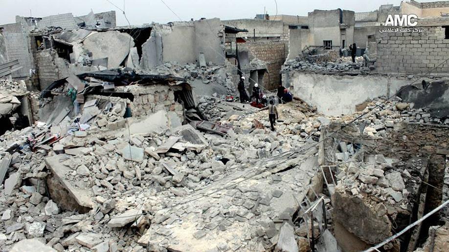 e04e6d8c-Mideast Syria Barrel Bombs