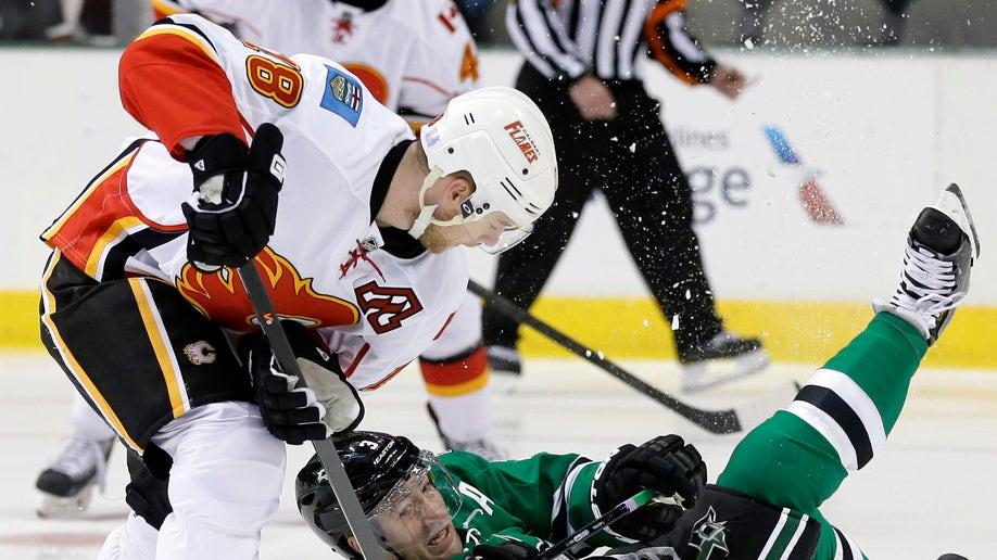 APTOPIX Flames Stars Hockey
