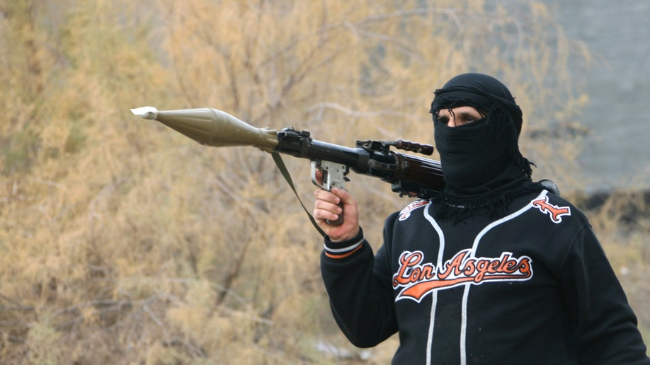 c85e296c-Mideast Al Qaida Comeback