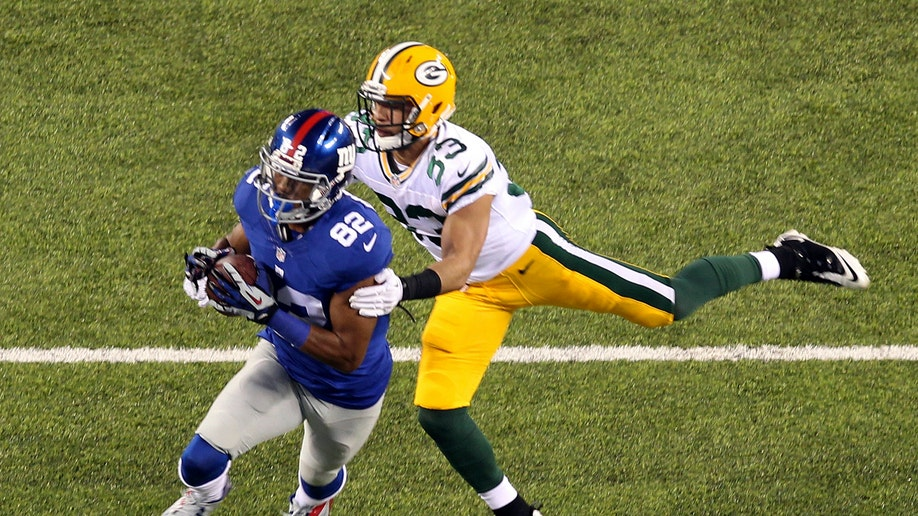 5b8c0107-Packers Giants Football