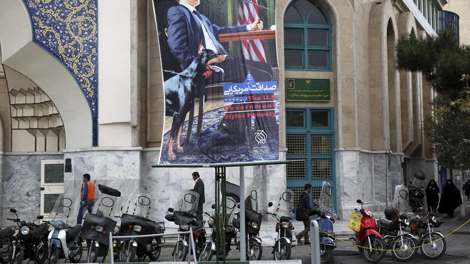 af0e15fd-Mideast Iran Poster Pressures