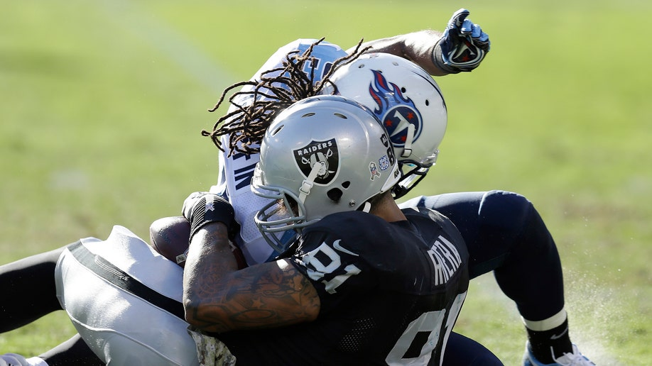479ab4e3-Titans Raiders Football