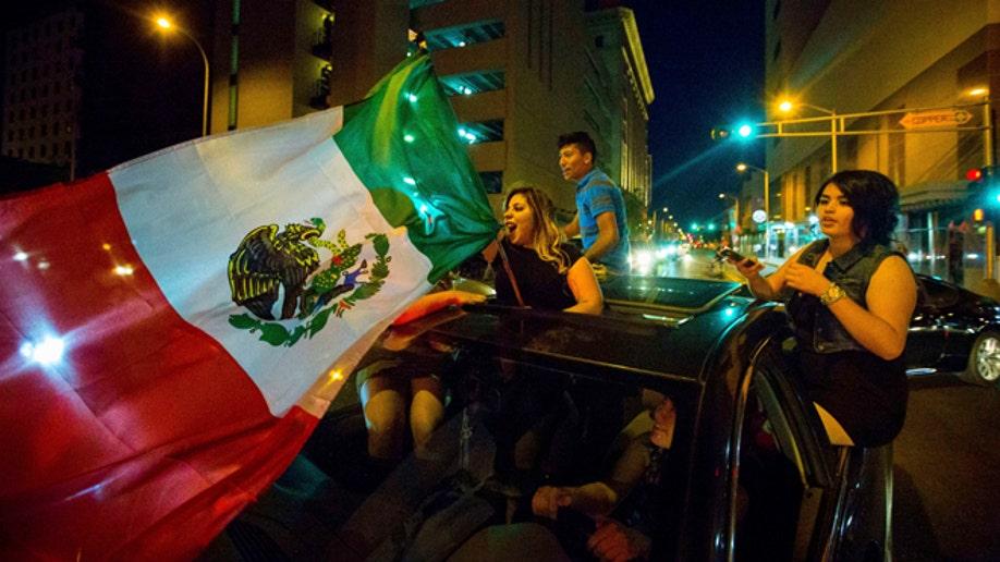 afc86b9c-GOP 2016 Trump Mexican Flag