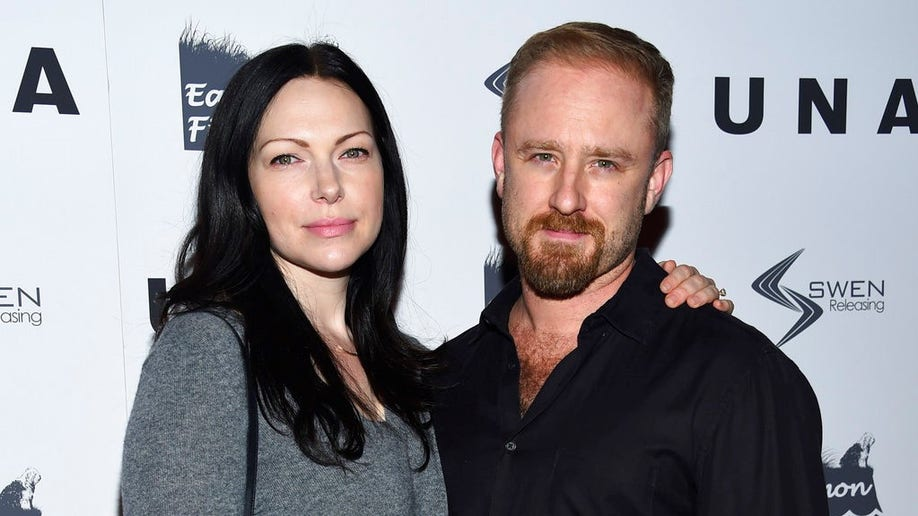 FILE - In this Oct. 4, 2017, file photo, actors Laura Prepon, left, and Ben Foster attend the premiere of