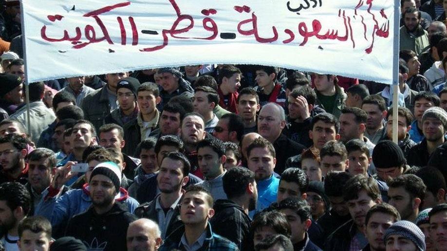 d75a3705-Mideast Syria Qatars Role