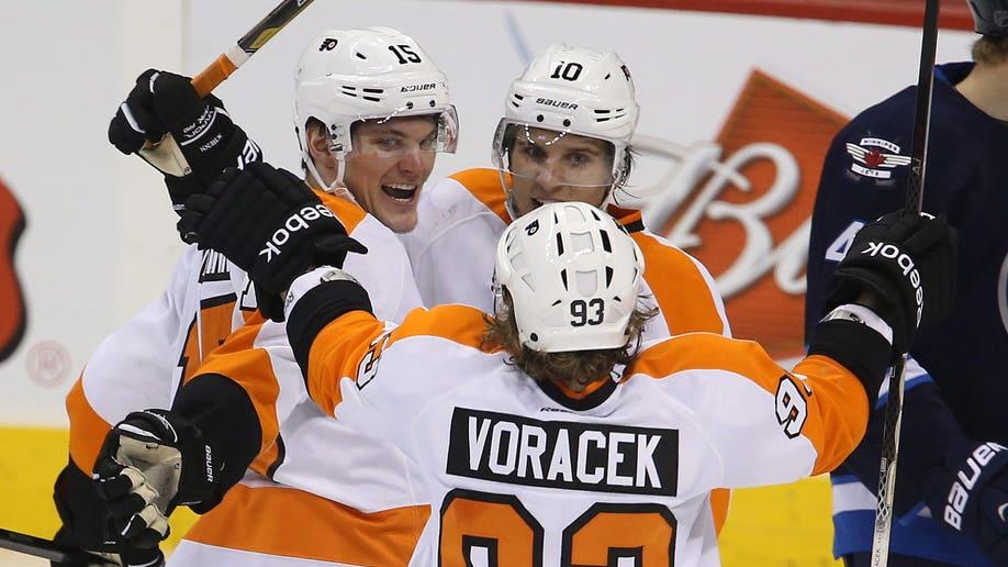 f6b76348-Flyers Jets Hockey
