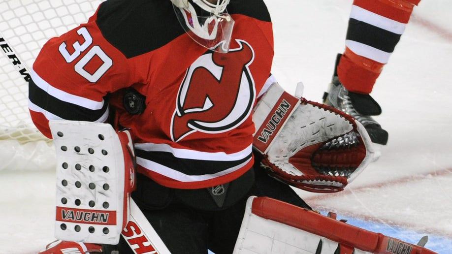 f8fc2530-Hurricanes Devils Hockey