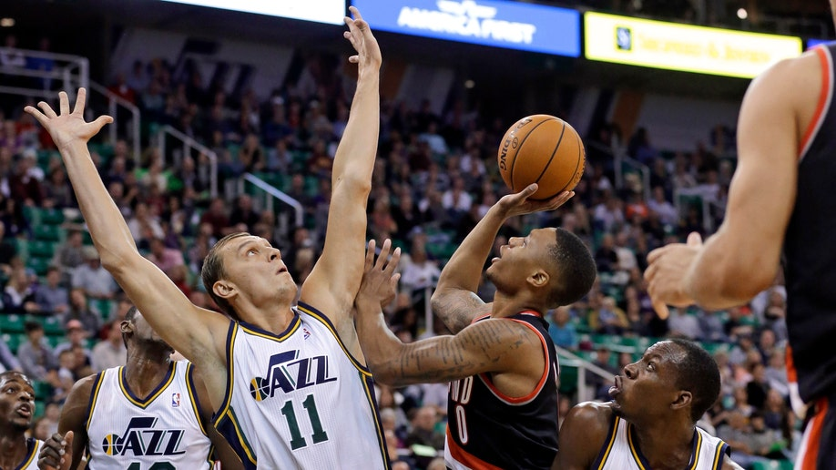 APTOPIX Trail Blazers Jazz Basketball
