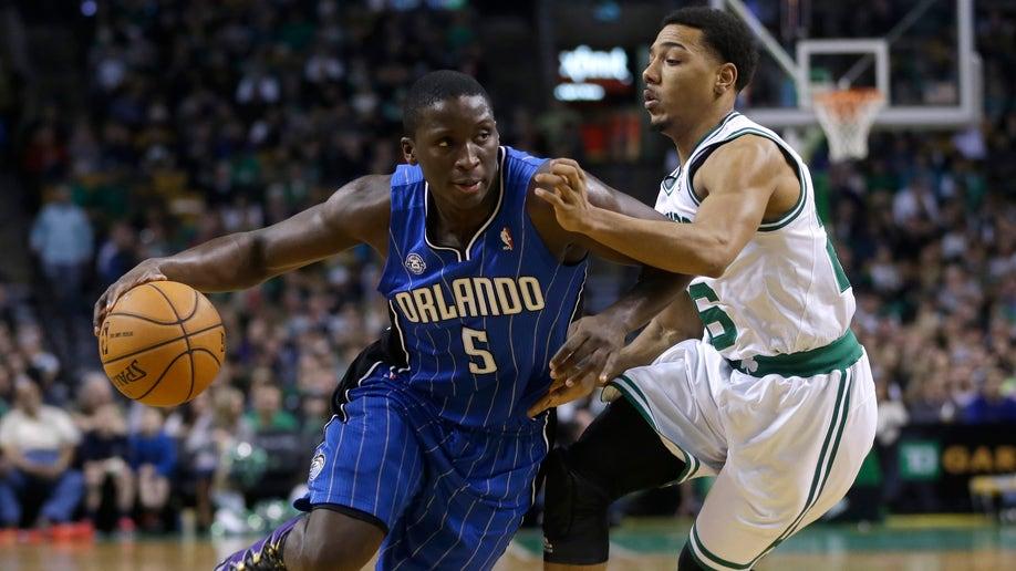 839be917-Magic Celtics Basketball