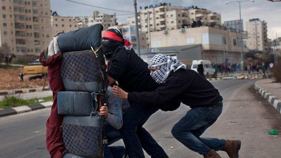 be16d71c-APTOPIX Mideast Israel Palestinians
