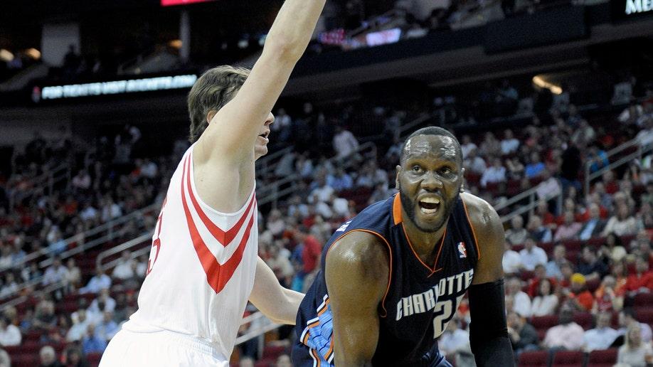 61cddb00-Bobcats Rockets Basketball