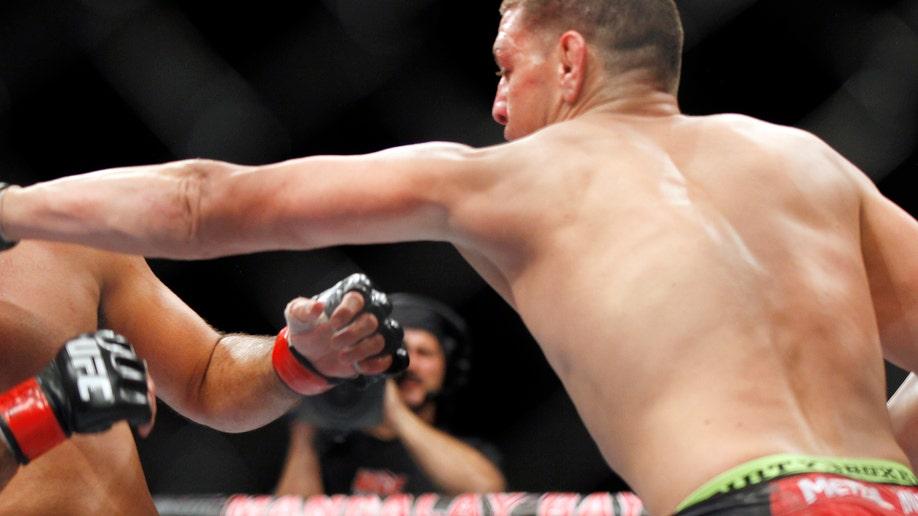 c8607e92-APTOPIX MMA UFC 137 Penn Diaz