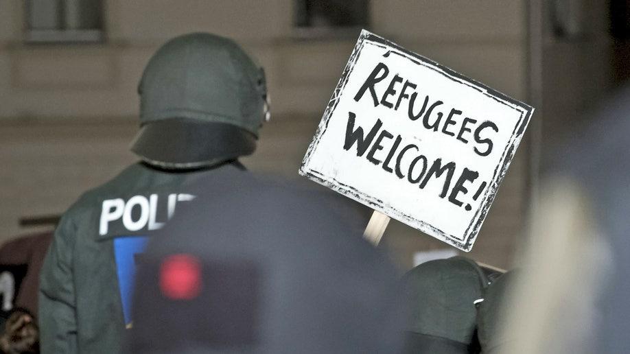 e93e80d1-Germany Refugee Camp Demonstration