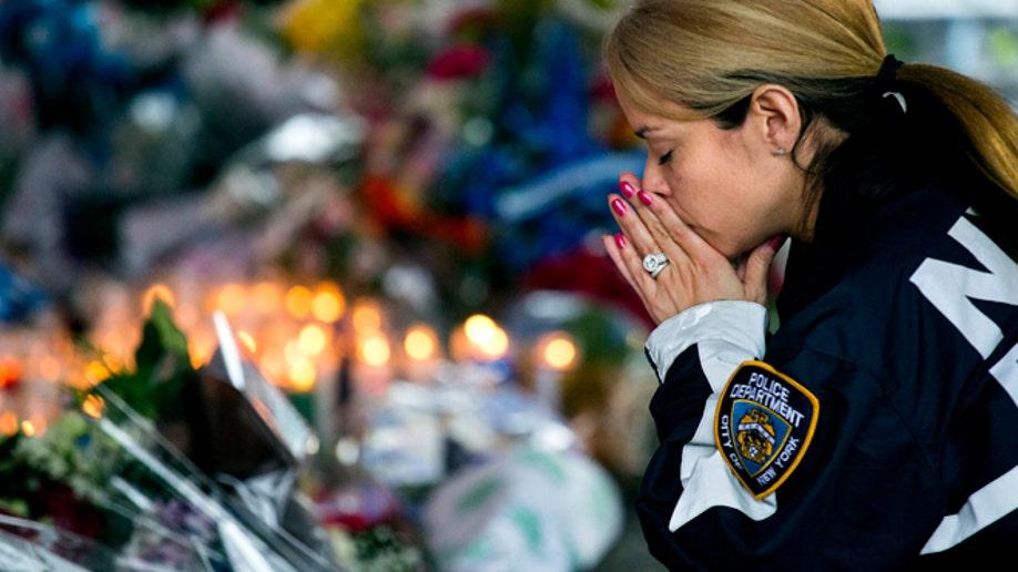 ca211d2c-APTOPIX NYPD Officers Slain Developments
