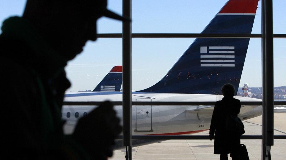4b352fc9-American-US Airways-Traveler Impact