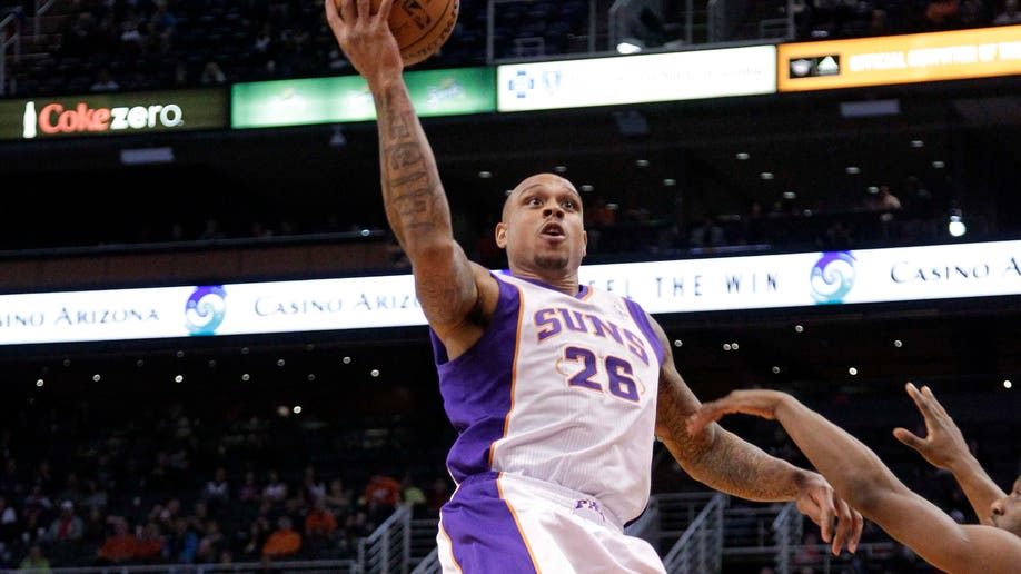 d6040c47-Bobcats Suns Basketball