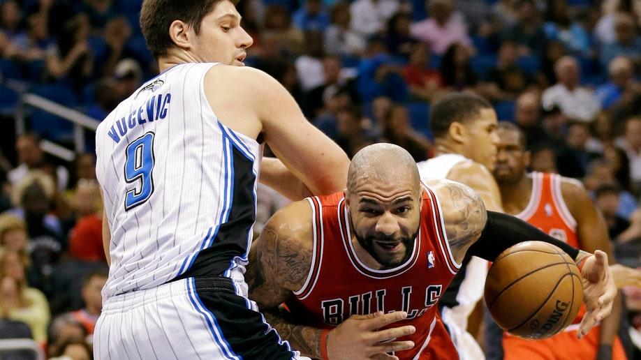 83e30df7-Bulls Magic Basketball