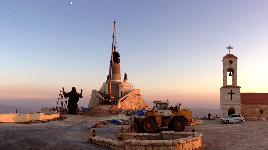 45d9cecf-Mideast Syria Jesus Statue