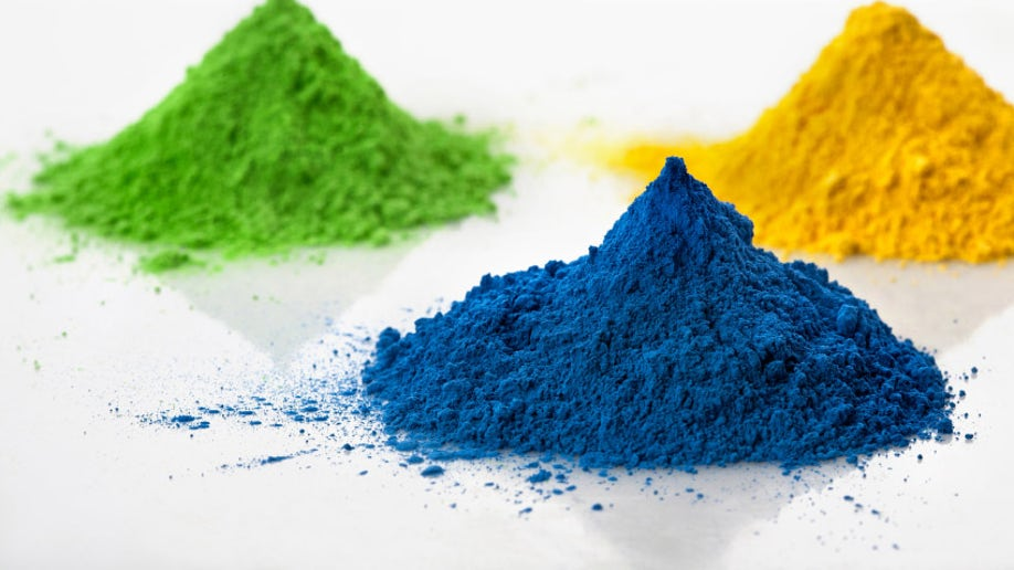 Three color pigments on white background