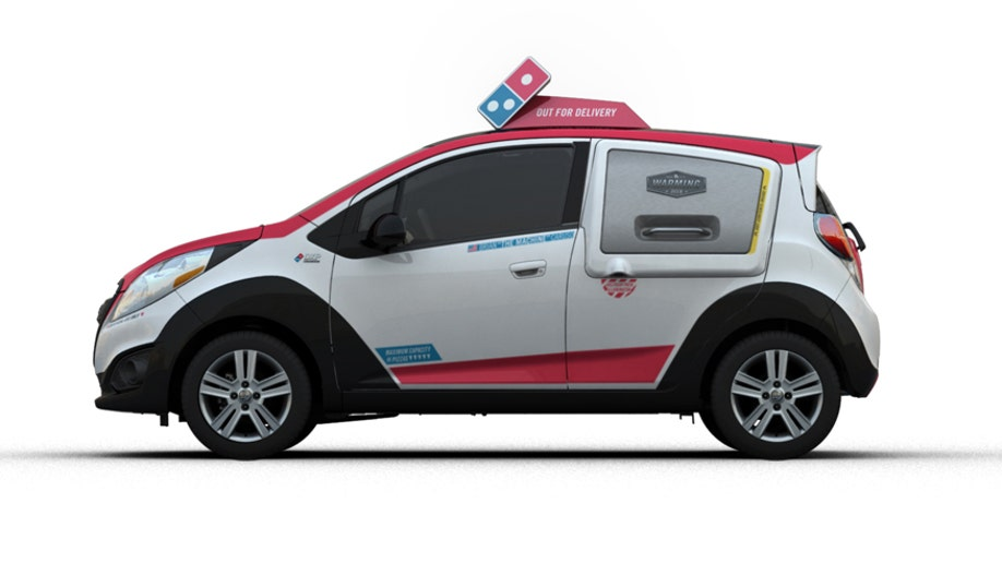 47ba5945-Dominou2019s announced today it has chosen the 2015 Chevrolet Spark as the basis for the companyu2019s new Dominou2019s DXP ™(Delivery Expert).