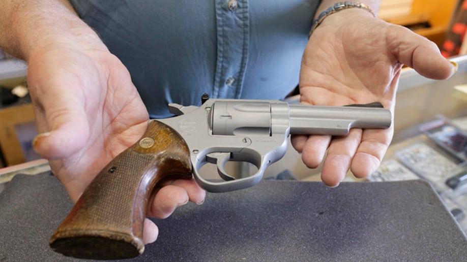 6ac02369-LAPD Revenge Killings Gun Auction