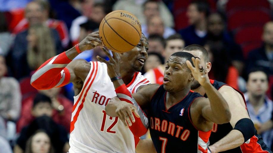0a5a29f9-Raptors Rockets Basketball