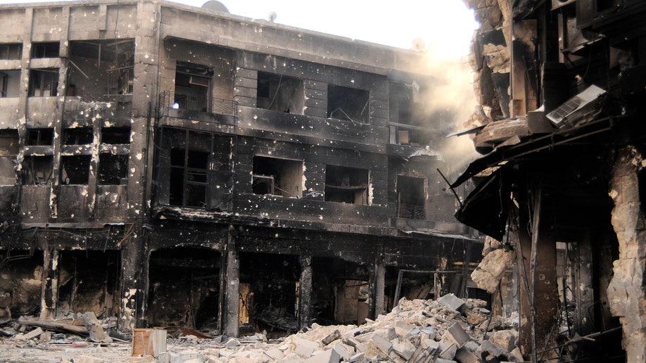 55bd0b7d-Mideast Syria Fleeing Elite