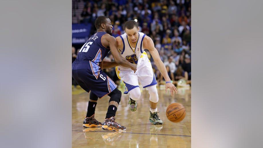eed9fce6-Bobcats Warriors Basketball
