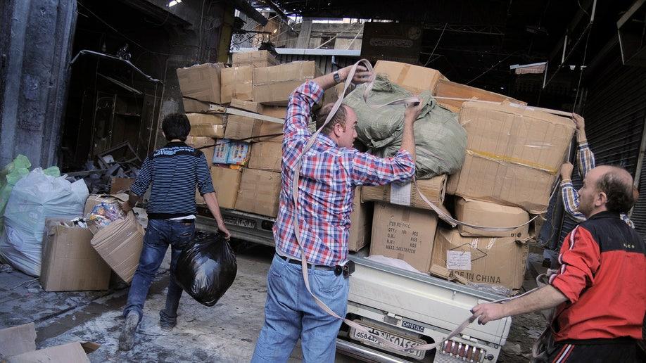 Mideast Syria Fleeing Elite