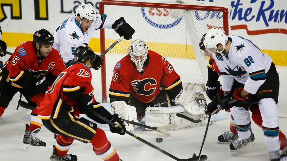 4fa4f9b8-Sharks Flames Hockey