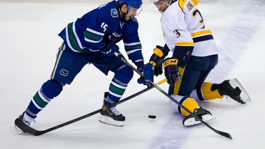 a375d481-Predators Canucks Hockey