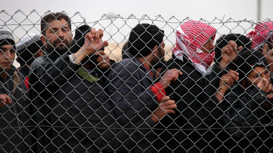 63fecad7-Mideast Jordan Syrian Refugees