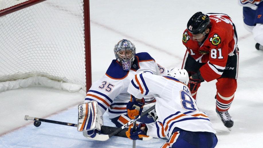 f404bdc2-Oilers Blackhawks Hockey