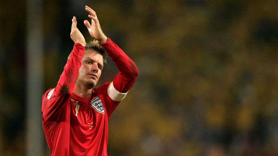 ed3f410b-Beckham Retires Soccer